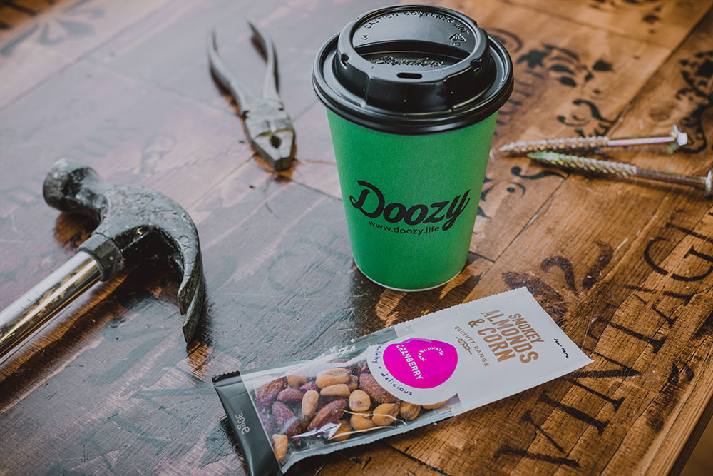 doozy fair trade coffee cup with tools