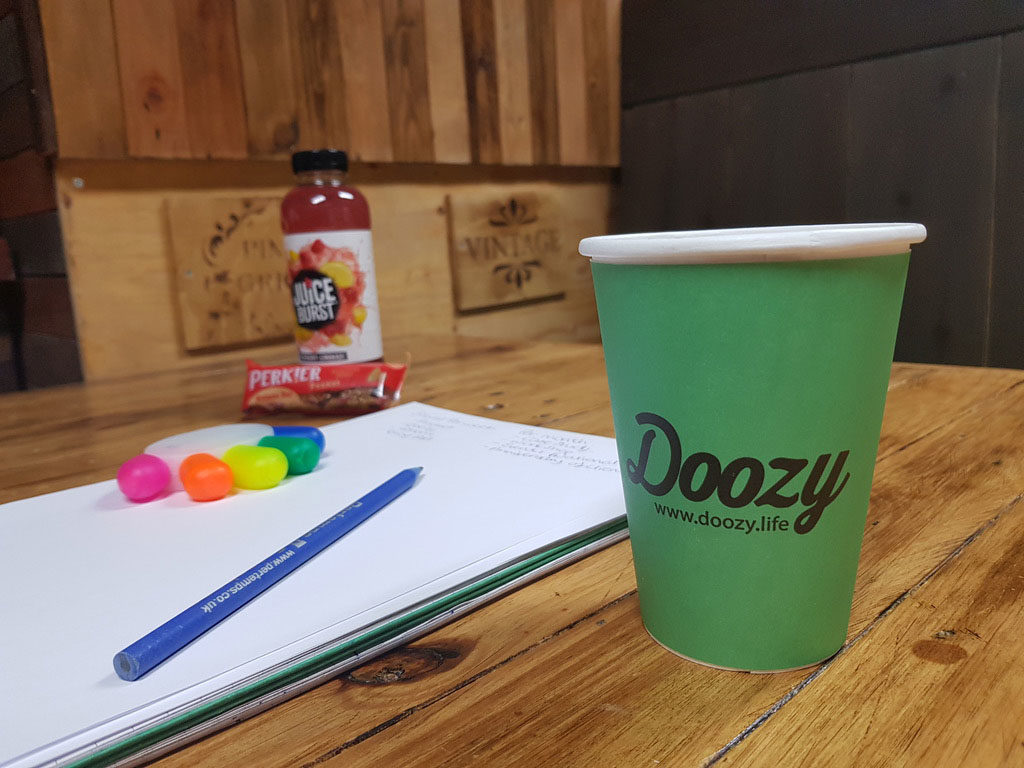 Doozy coffee machine cup with snacks